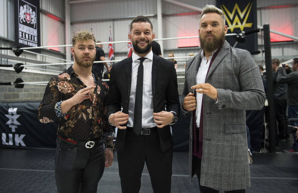 Finn Balor (centre) is joined by Tyler Bate (left) and Trent Seven (right)