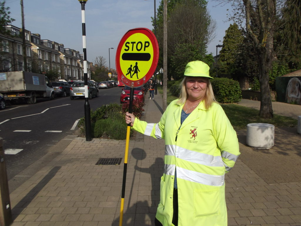 Lesley Robinson on duty at the zebra crossing in Church Street, Edmonton