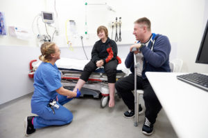 A nurse treats a patient (credit NHS England)