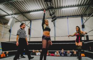 Enfield wrestler Mariah Mays salutes the crowd