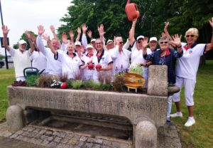 Members of Selborne Bowling Club celebrate planting up a drinking trough in Southgate