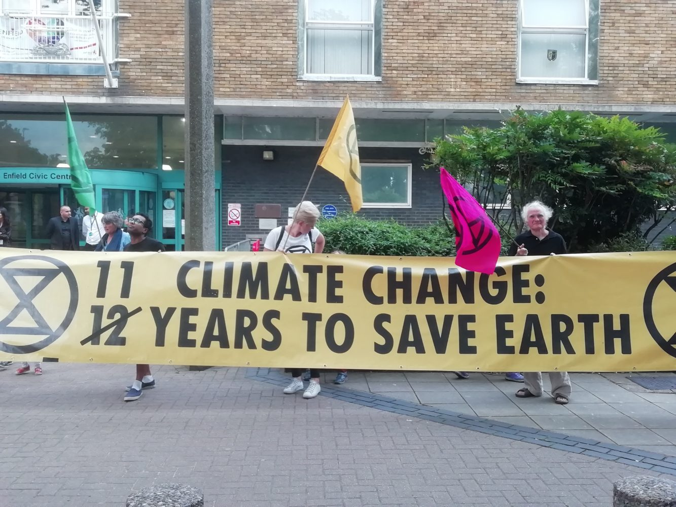 Activists from Enfield Extinction Rebellion stage a protest outside Enfield Civic Centre