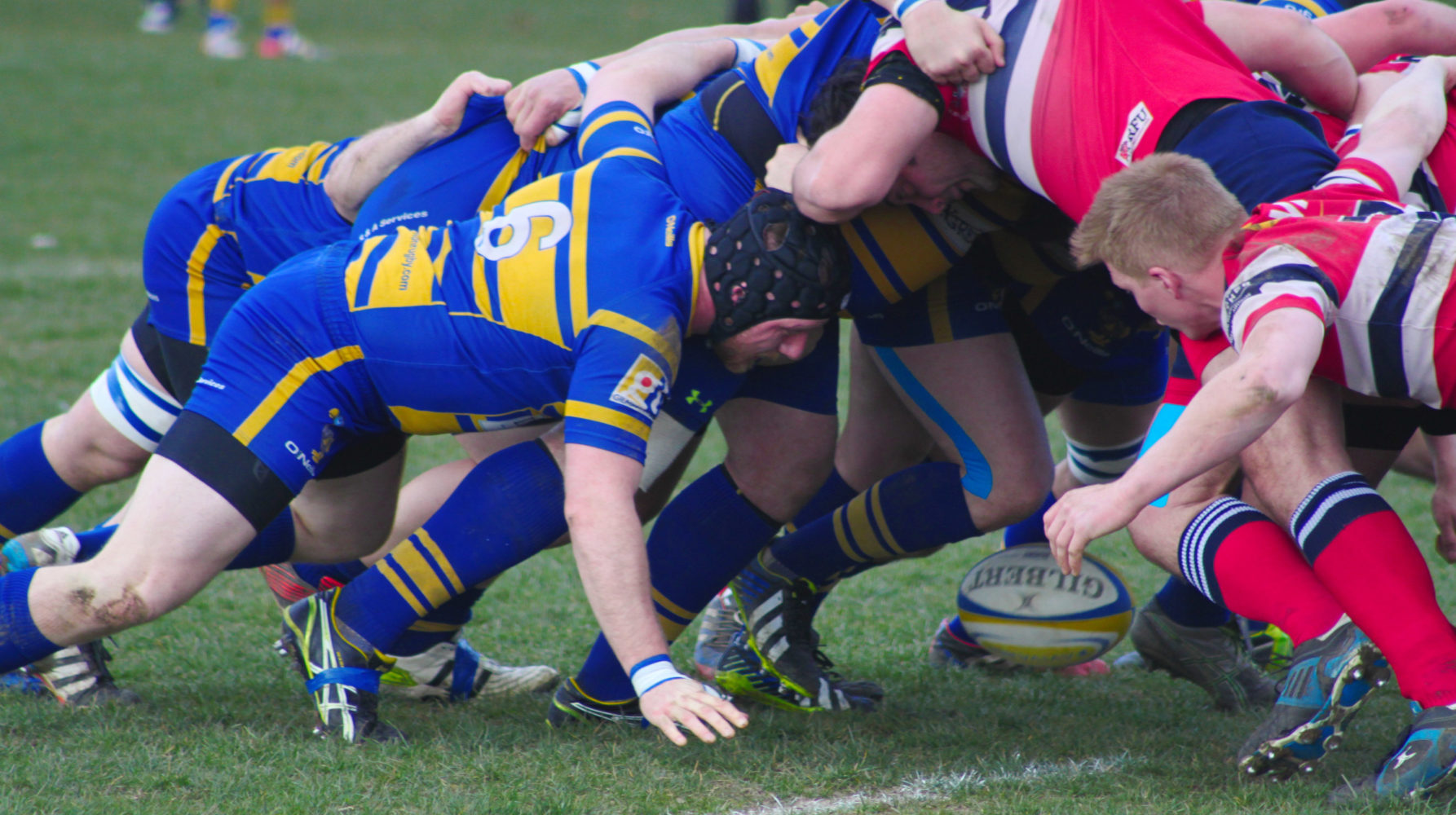 Enfield Ignatians, in blue and gold, compete in a scrum last season