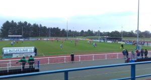 Enfield Town FC competing at Queen Elizabeth II Stadium in Donkey Lane
