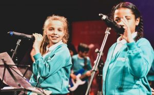 Pupils from Churchfield Primary School were among more than 100 who rocked out on stage at Millfield Theatre (credit Roy Ikoroha)