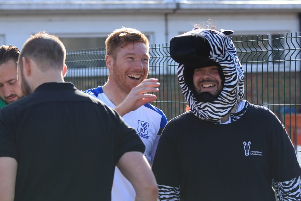Enfield Town FC's Marc Weatherstone (centre) with Zebras Children and Adults' Charity co-founder Jamie Ashton (zebra costume)