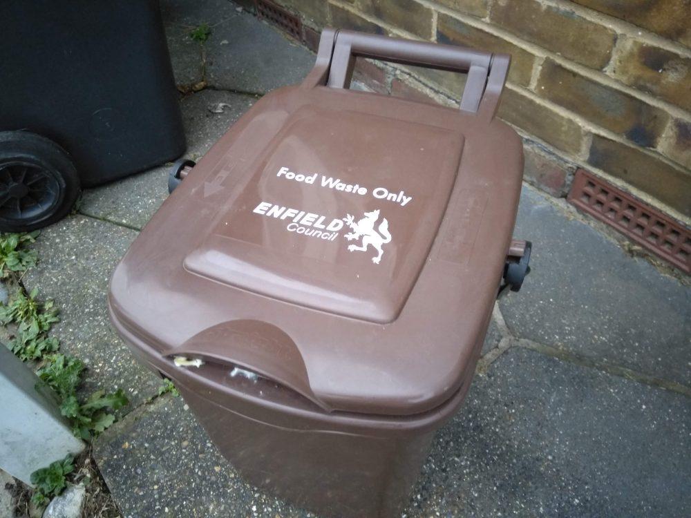 A brown food waste bin