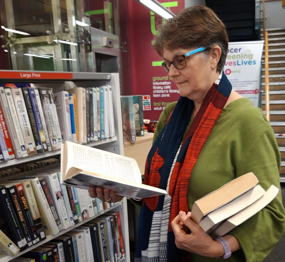 Volunteers such as Frances help choose books for the home delivery service