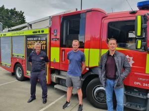 Brian Mottram (centre) was rescued as a baby by firefighters Simon Cullen (right) and Billy Merrifield (left)