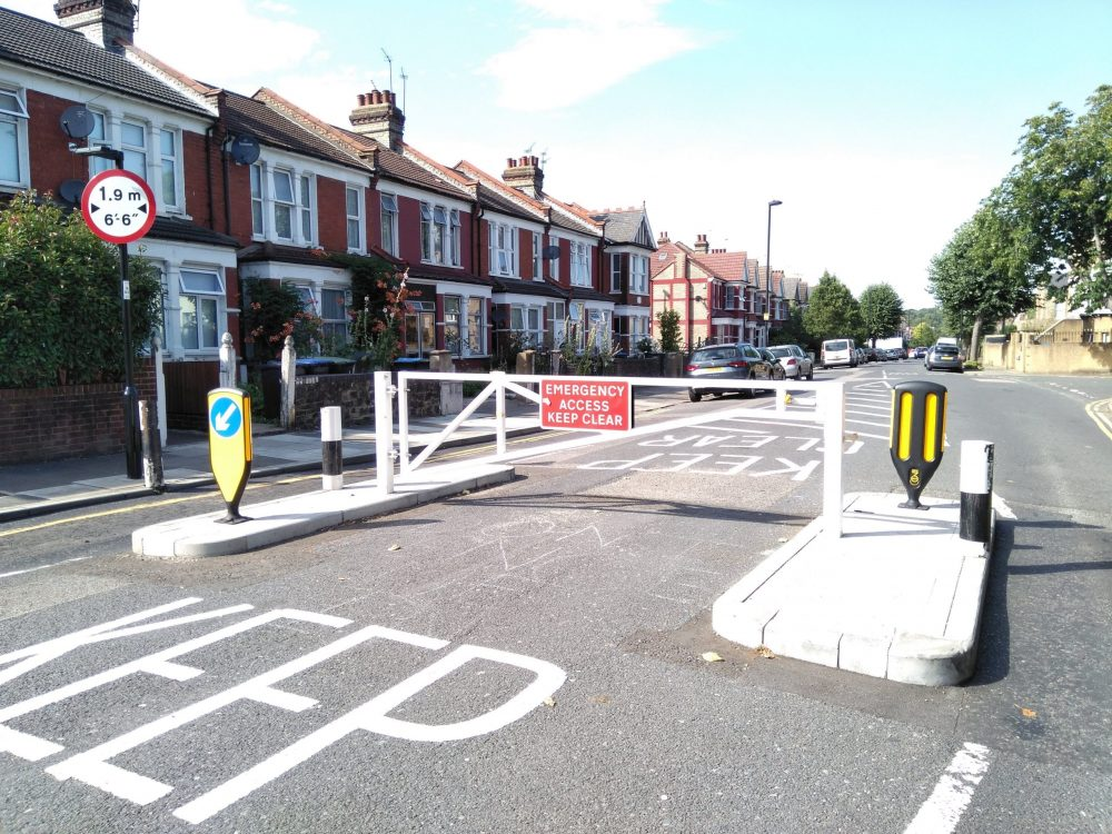 A barrier was installed a few years ago to create a width-restriction for vehicles, but the problem has persisted.