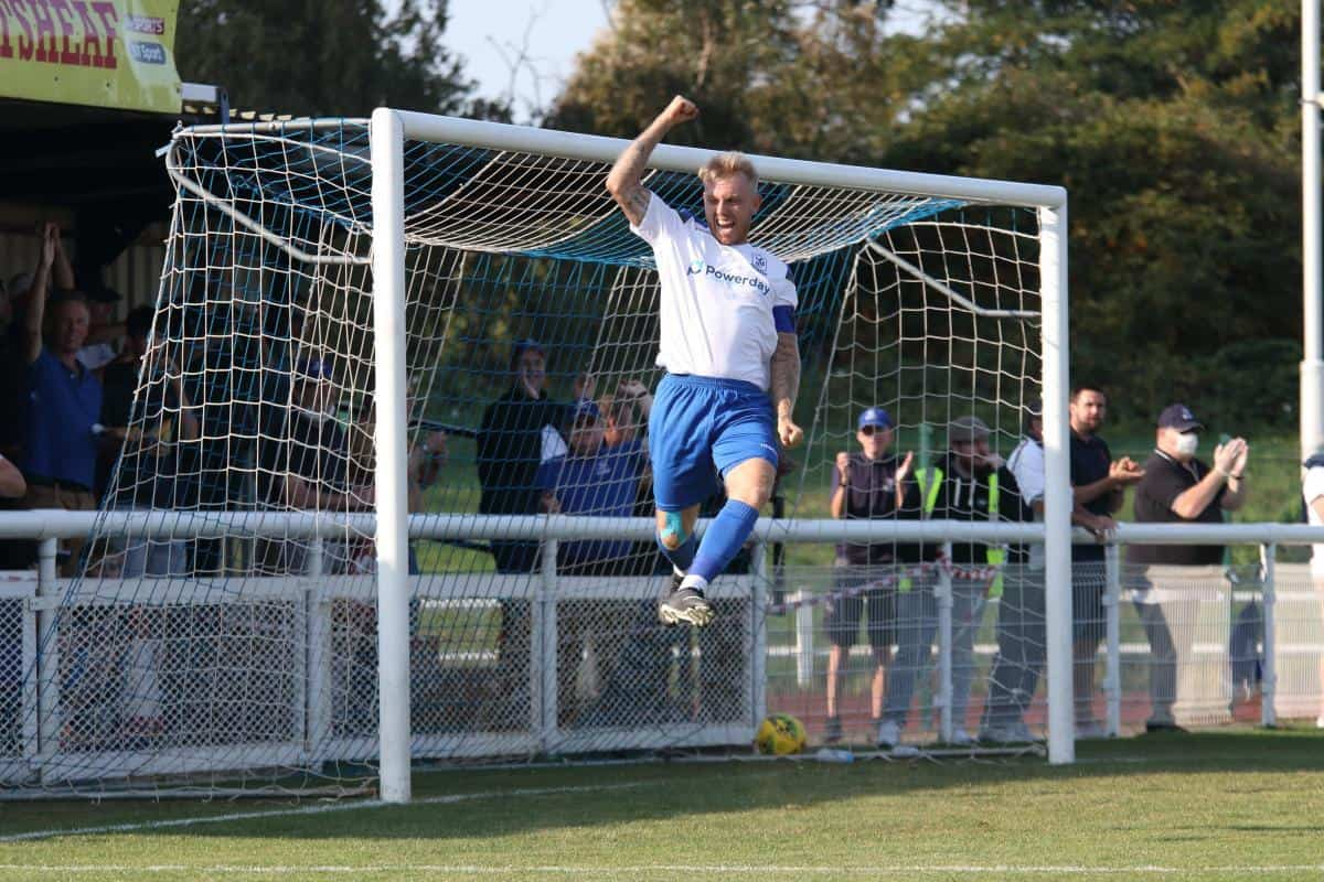 Ryan Blackman celebrates his goal for Enfield Town against Lewes (credit Tom Scott)
