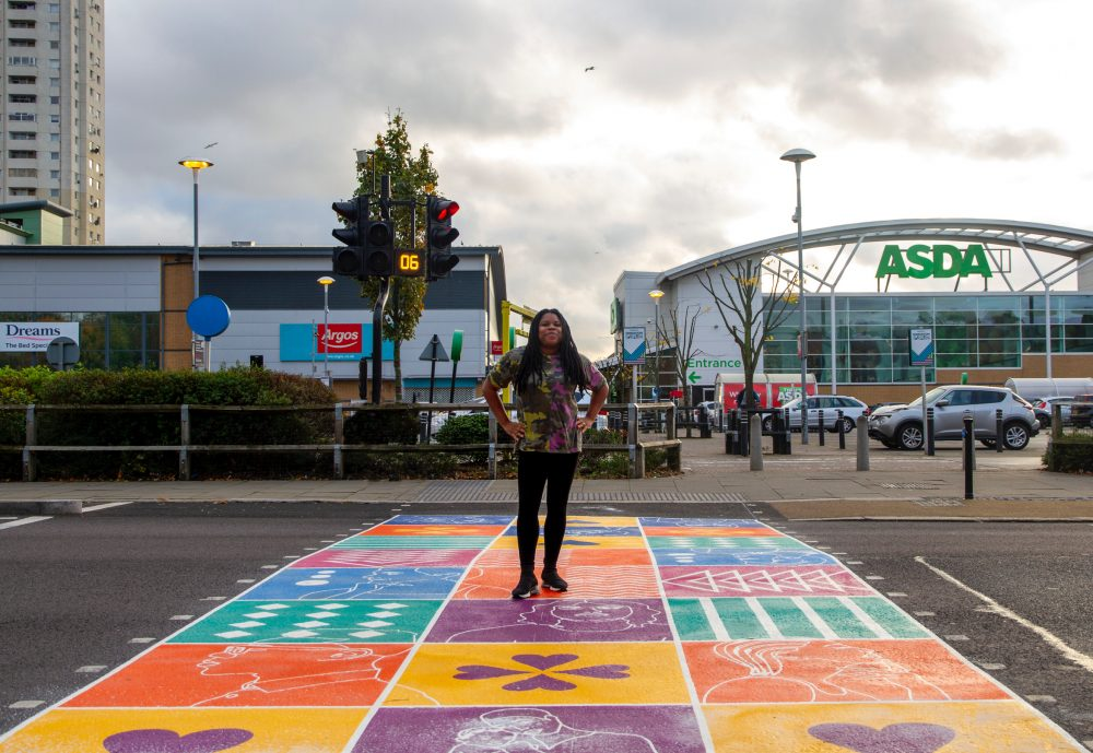 Artist Kareen Cox with her colourful crossing in Fore Street