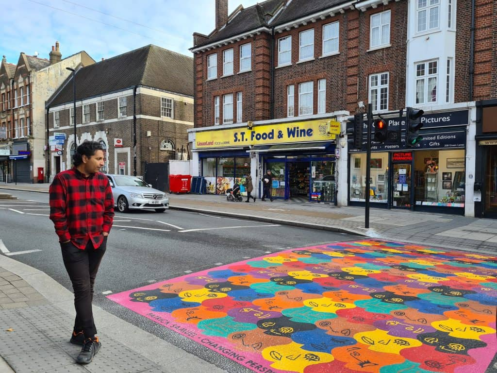 Artist Patrick Samuel at the crossing he designed in Green Lanes
