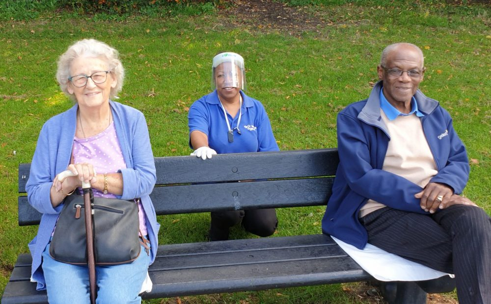 Age UK Enfield's services have been in demand during the pandemic. Pictured from left are Cynthia Clarke, care worker Jean Luftig, and Alfonseo Douglas
