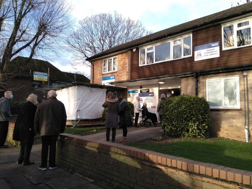 Patients queue for Covid-19 vaccinations at Carlton House Surgery in Enfield