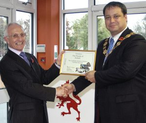 David Lowbridge from Fairtrade Foundation (left) presents a certificate declaring as a Enfield a Fairtrade borough to then mayor Lee Chamberlain (right) in 2008 (credit Keith Emmitt)