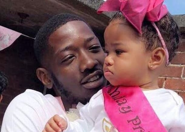 Murdered dad James Amadu pictured with his young daughter