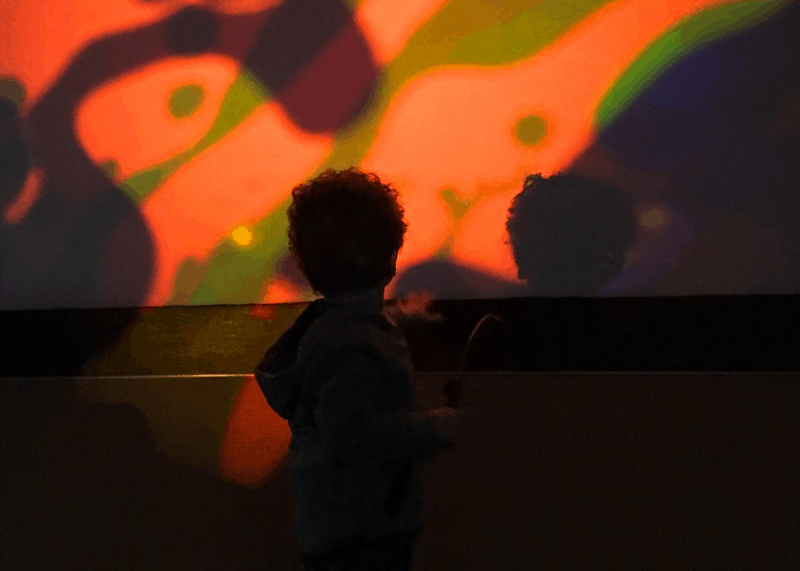 Edward, age 3, engaging in sensory play at a SEN-den playgroup, a safe place in Enfield for families of young, autistic children to access play, information and support in the community (credit Lubna Reid)