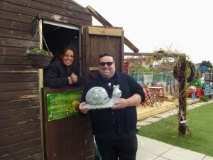 Sonny the Snail's founder Kari Payne with garden volunteer Hayes Rees, a fundraiser with MacMillan