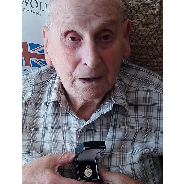 Bill Plume with his veterans badge, after being supported by Age UK Enfield