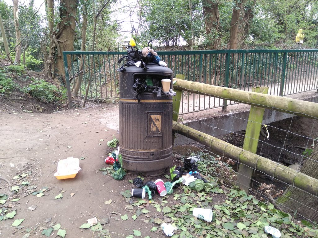 An overflowing bin in Forty Hall Park