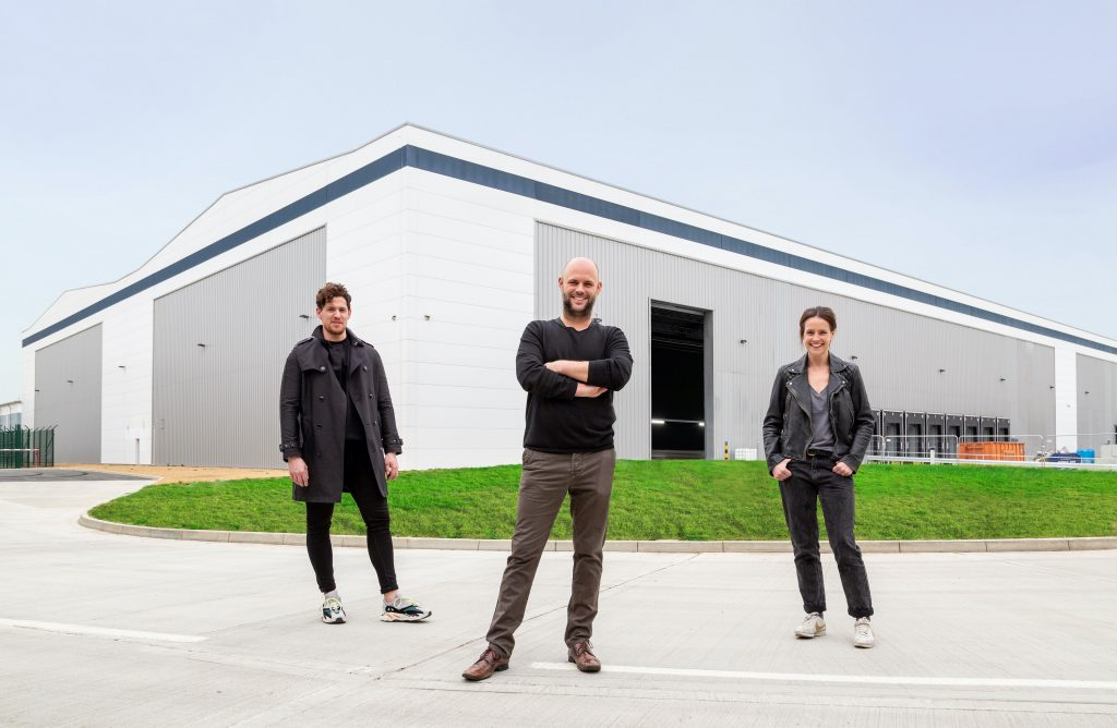 Outside OMA:X Film Studios in Enfield Lock are (from left) James Hanford, head of acquisitions at Location Collective; Antony Iredale, managing director; and Becky Butler, head of operations