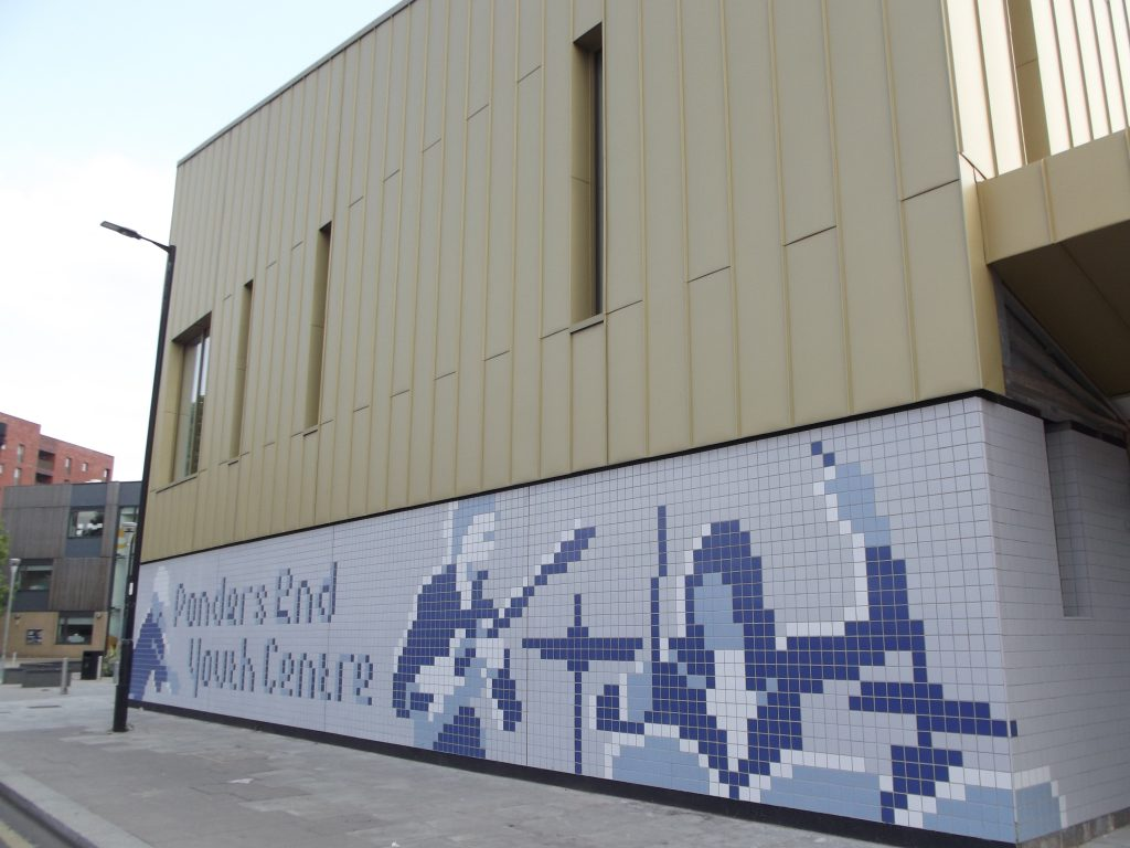 The outside of the new Ponders End Youth Centre building in South Street features a tile mural