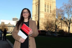 Council leader Nesil Caliskan with the Poverty and Inequality Commission report outside parliament