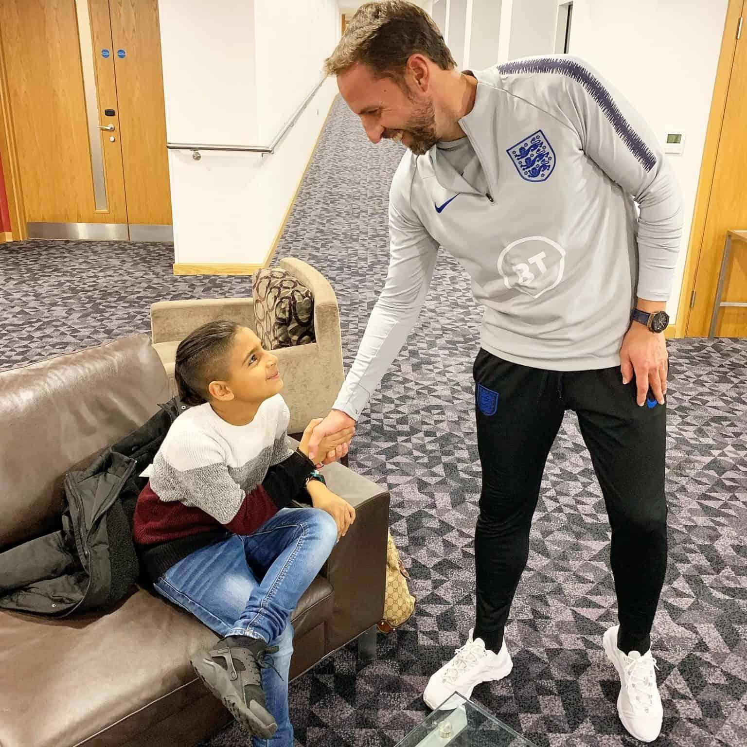 Mikey Poulli meeting England boss Gareth Southgate