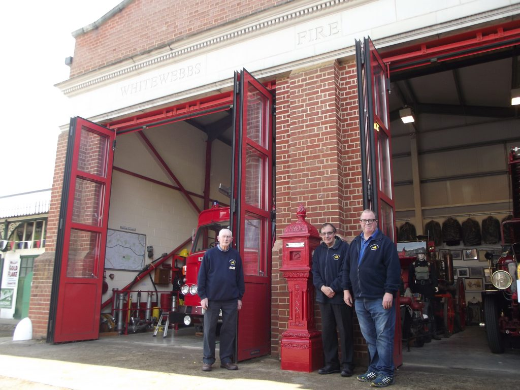 Outside the mock fire station at The Whitewebbs Museum of Transport are Alex Watt, chair of Enfield and District Veteran Vehicle Trust (left), plus trustees Chris Whippe (centre) and Robert Haydock (right)