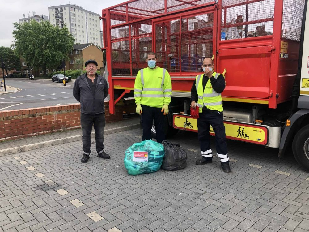Cabinet member for environment Rick Jewell (left) with some of Enfield Council's street waste collection team