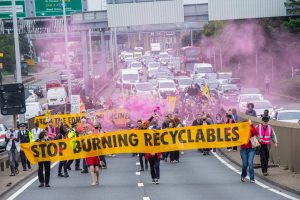 """Incinerator protestors march along the North Circular with a sign saying """"stop burning recyclables"""" (credit Extinction Rebellion)"""