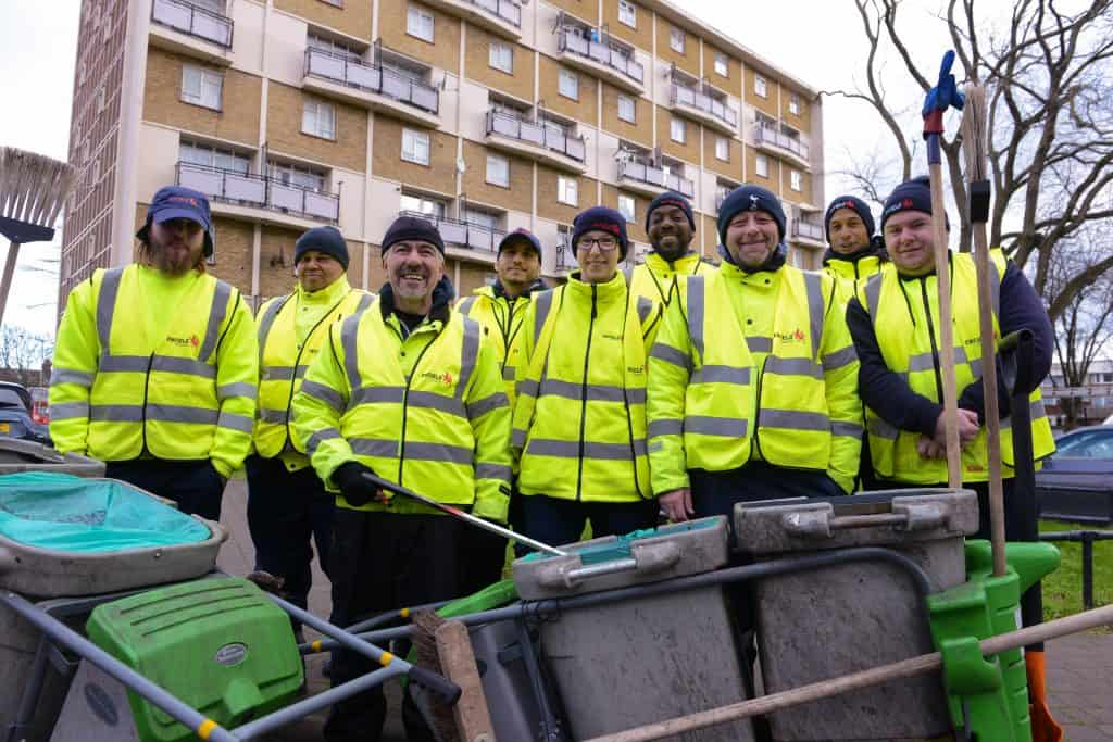 Some of Enfield Council's street-cleaning team pictured collecting waste in Angel Edmonton
