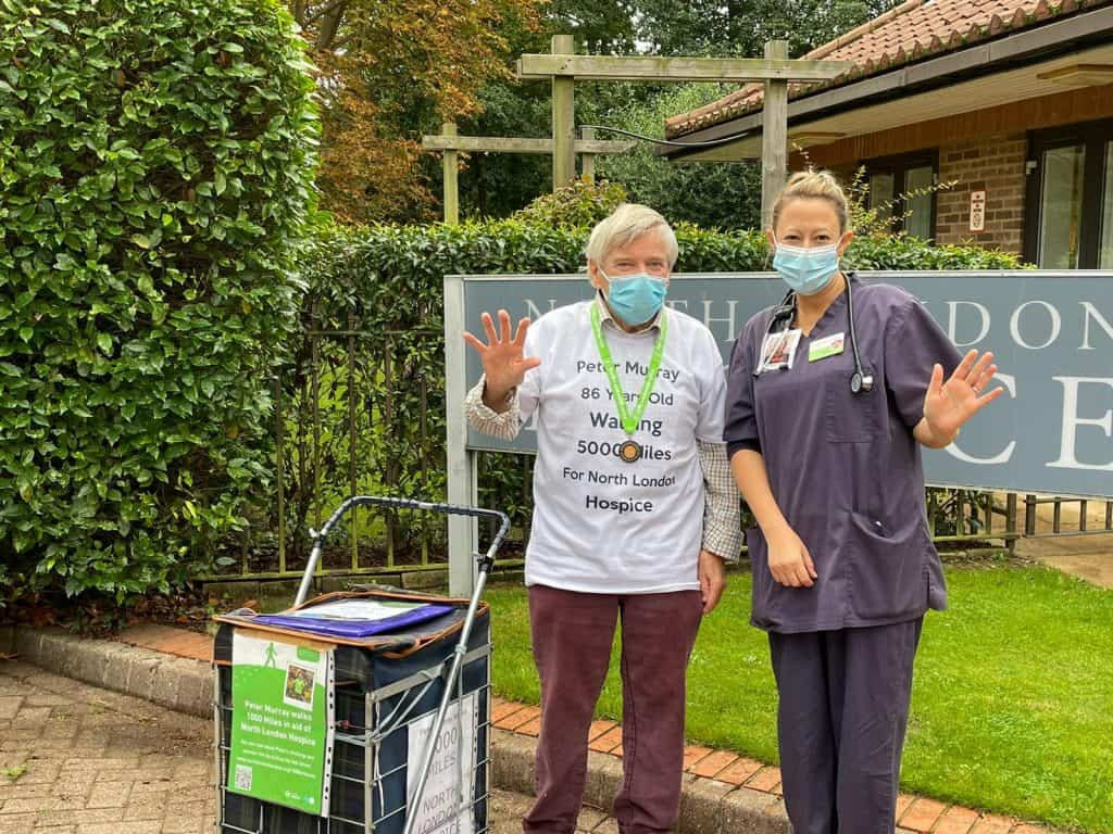 Peter Murray celebrates the completion of his 1,000-mile walk at North London Hospice with medical director Sam Edwards - and the start of a new 5,000-mile mission